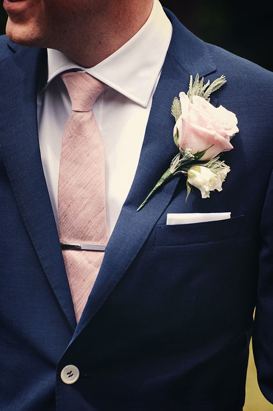 Navy blue groom suite and peach tie