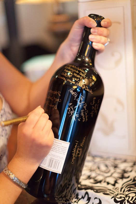 The couple had guests sign a magnum bottle of wine that they would share on their anniversary