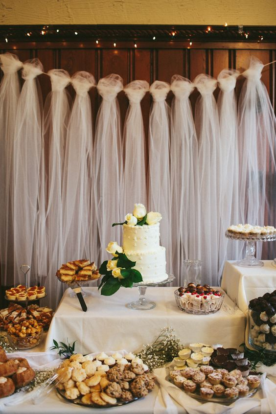 We Love This Tulle Wedding Backdrop elegant and this use is original and perfect for weddings