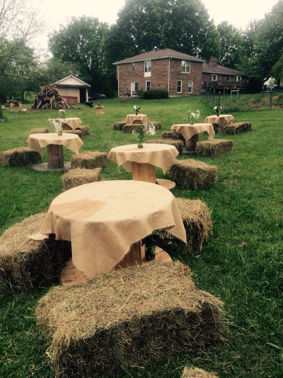 Wire spool tables with burlap hay bale seating