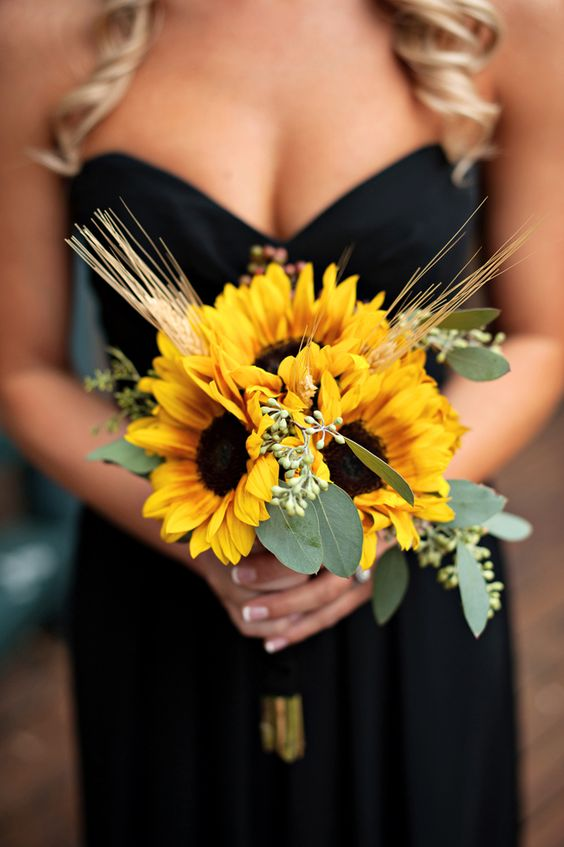 Black bridesmaid dress with sunflower bouquet