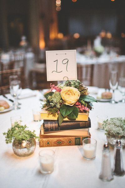 DIY Vintage Wedding Centerpieces - Books topped with Flowers