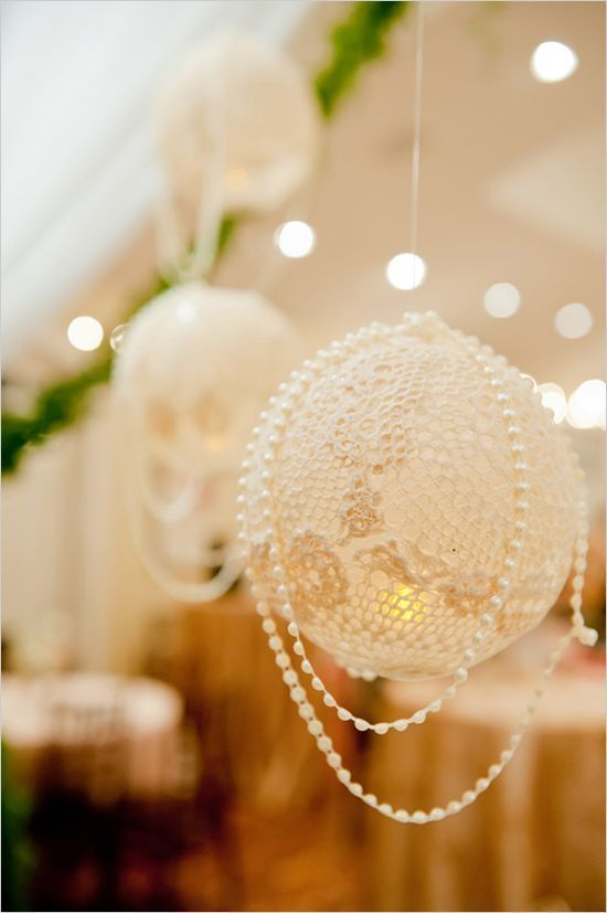 Lace lanterns with pearl decorations for a vintage wedding