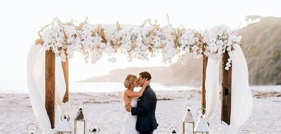 Love the flowers and lanterns and the finished look with the risers in the sand