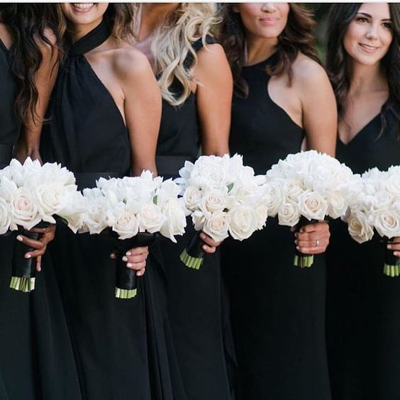 Loving these black bridesmaid dresses with white bouquets