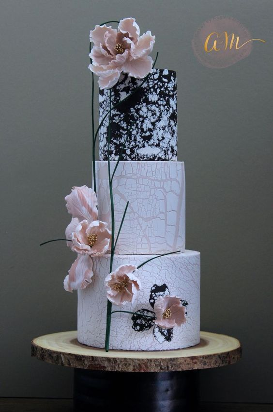 Modern black white and blush cake with three tiers