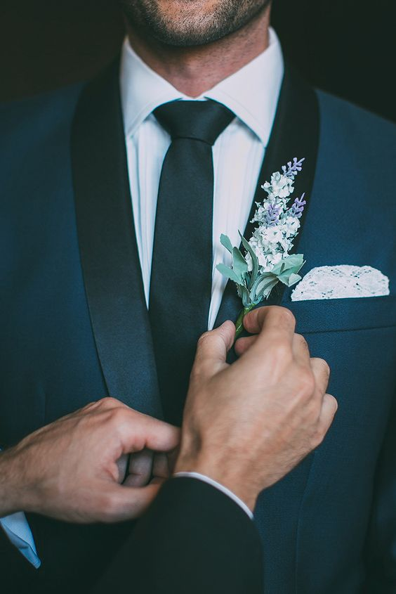 Navy groom suit with lavender boutonniere by Fiona + Bobby