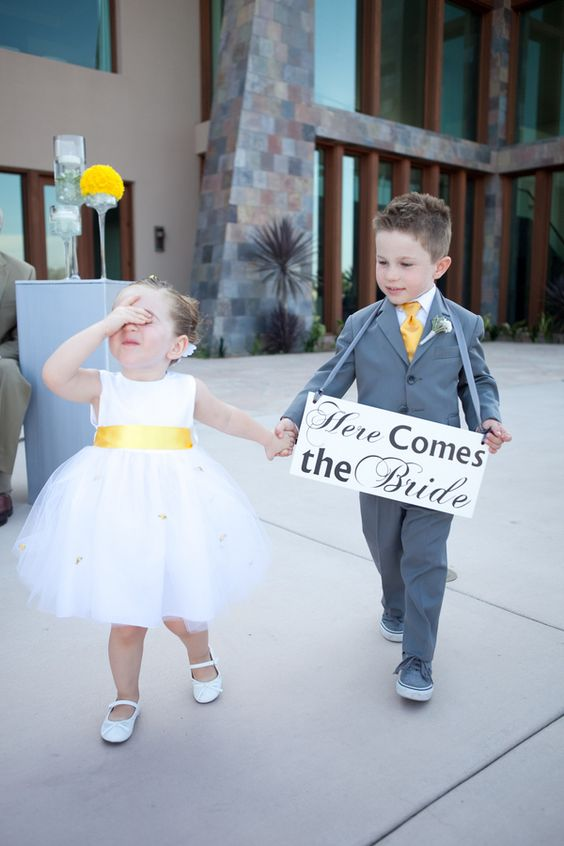 Ring Bearer in gray suit with yellow tie