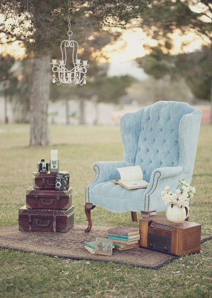 Shabby Chic Vintage Outdoor Reception with Blue Chairs and Old Suitcase