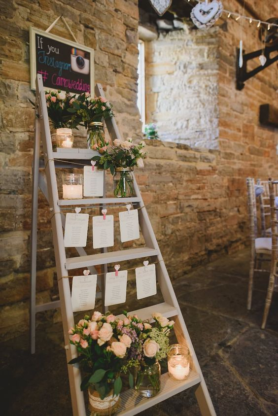 Step ladder table plan with candles and glass jars filled with flowers