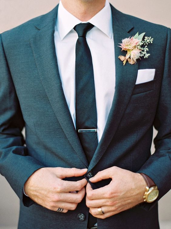 Stylish modern groom in a close-cut suit