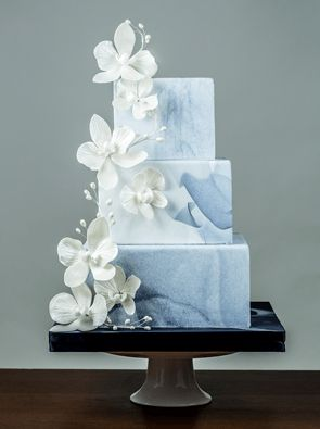 Sugar flowers and grey marble wedding cake