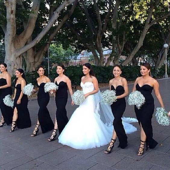 Sweetheart black bridesmaid dresses with baby breath bouquet
