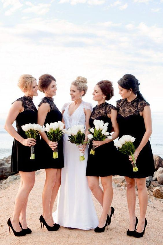 bridesmaids in black with white bouquets