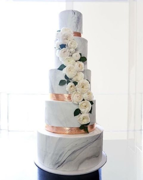 copper and marble wedding cake with flowers