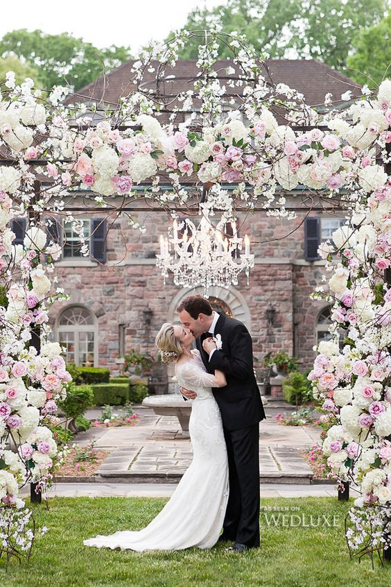 custom chuppah covered in pink and cream flowers