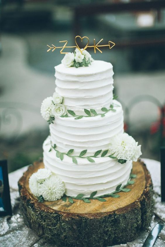 sweetest tree-trunk wedding cake with adorable golden topper