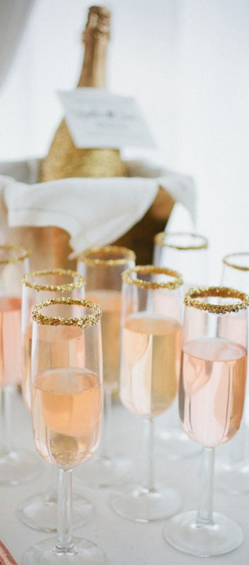Add gold sugar to the trim of your champagne glasses