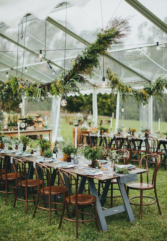Awesome outdoor wedding with greenery decorations