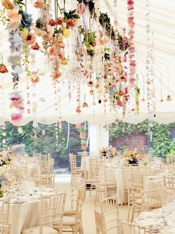 Brighten up a white tent with hanging florals