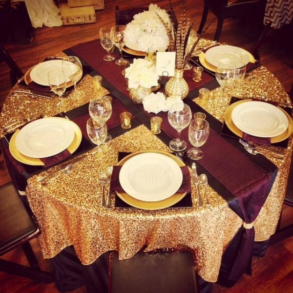 Dazzle up your fall wedding with a Burgundy and Gold guest table arrangement from Spielmans
