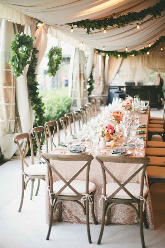 Decorate your wedding tent with lights and garland