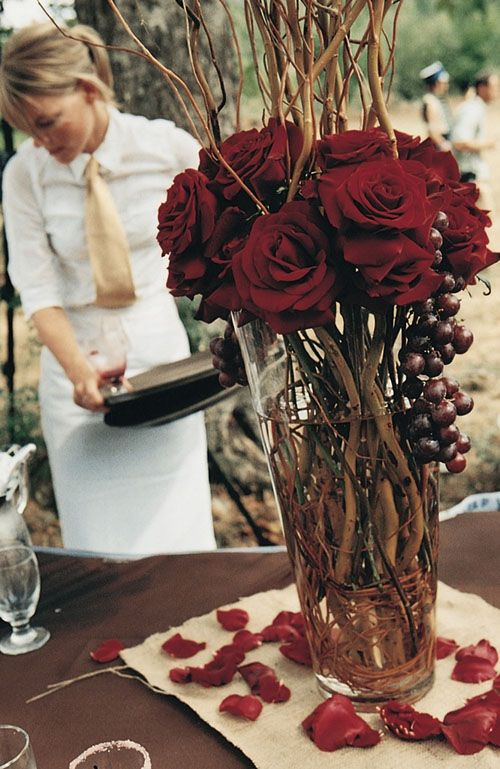 Deep red tones will add a romantic touch to your fall wedding