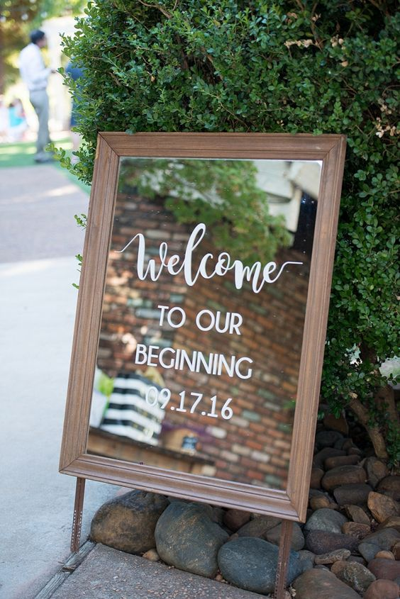 In love with this mirror welcome wedding sign