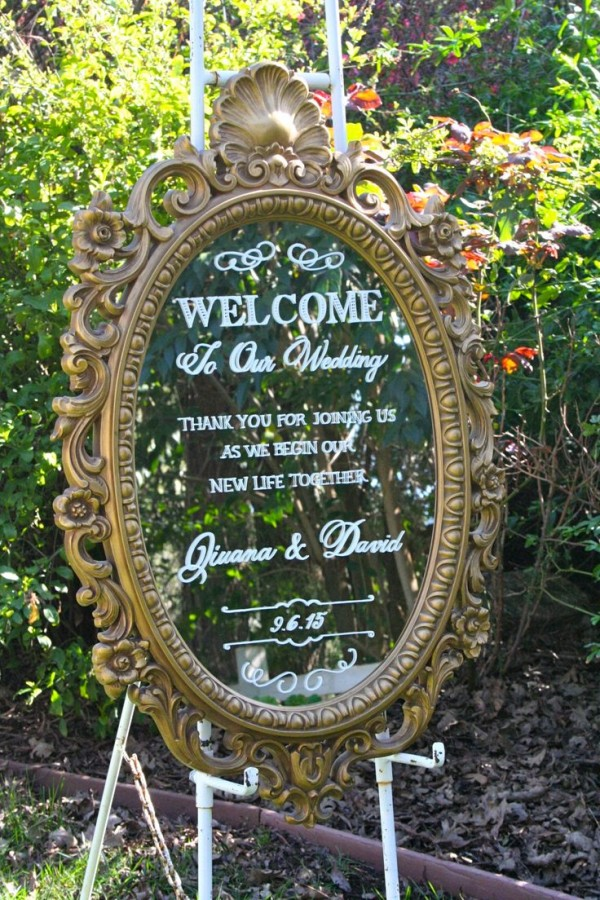 calligraphy on a mirror for welcome wedding entrance