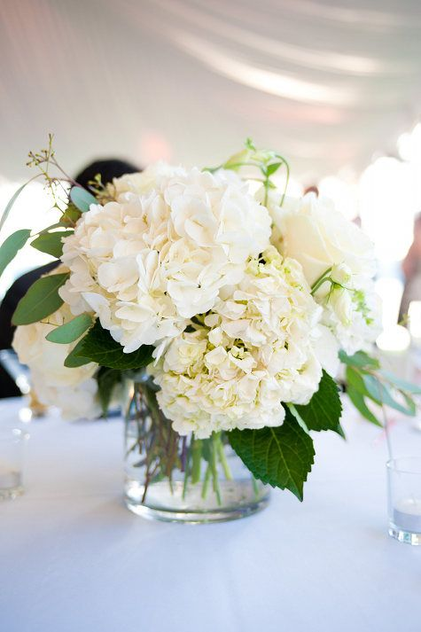hydrangeas and ivory spray roses centerpieces