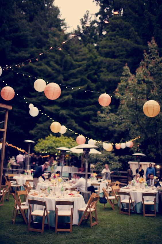 Beautiful backyard reception paper lanterns and stringed lights
