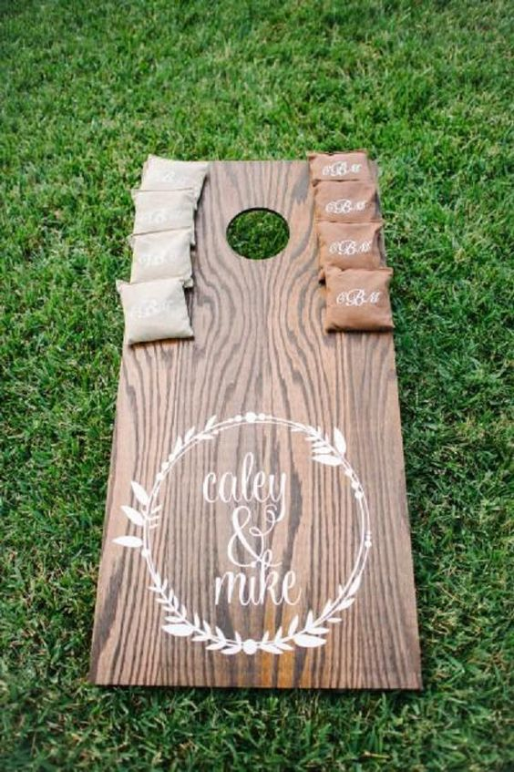 Cornhole for rustic backyard wedding