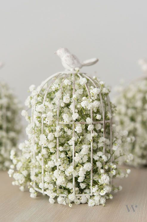 baby's breath decorated birdcage wedding decor