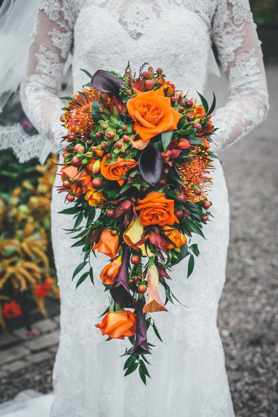 cranberry and protea fall wedding bouquet