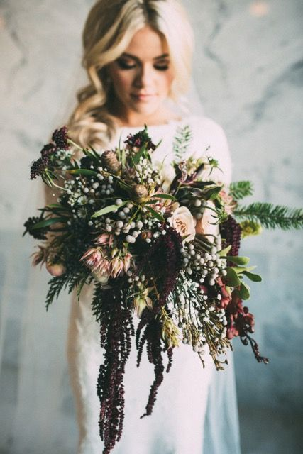 elegant giant botanical winter wedding bouquet