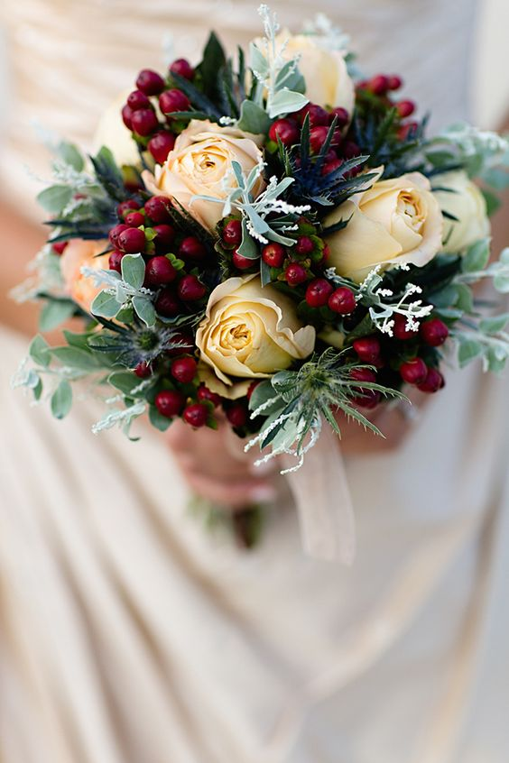 eye-catching champagne and red winter wedding bouquet