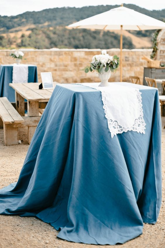 outdoor patio wedding with slate blue table cloths