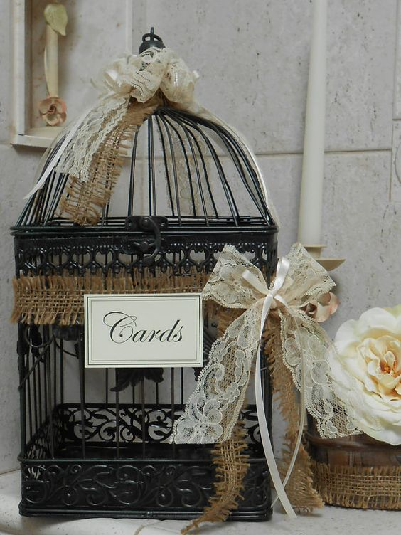 shabby black birdcage wedding decor with ribbons