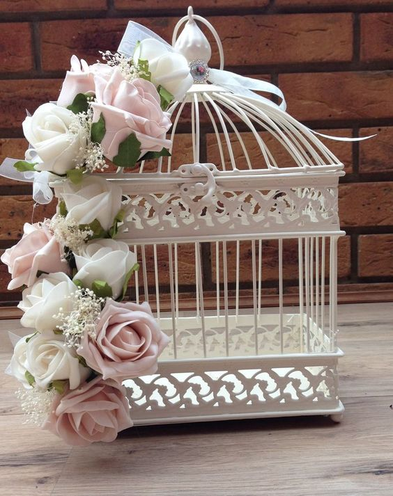 shabby chic birdcage wedding decorations with flowers