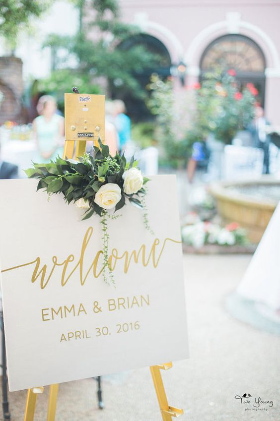 simple white and gold wedding welcome sign