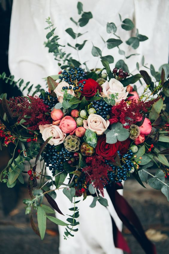stunning colorful winter wedding bouquet