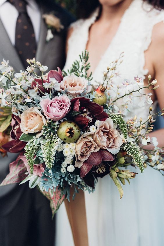 stylish peach orchard winter wedding flowers