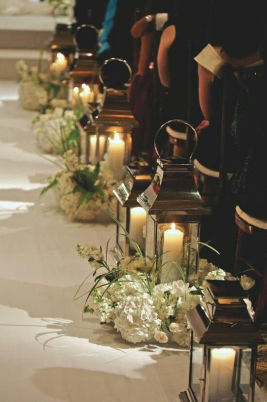 adorable church wedding with lanterns and flowers