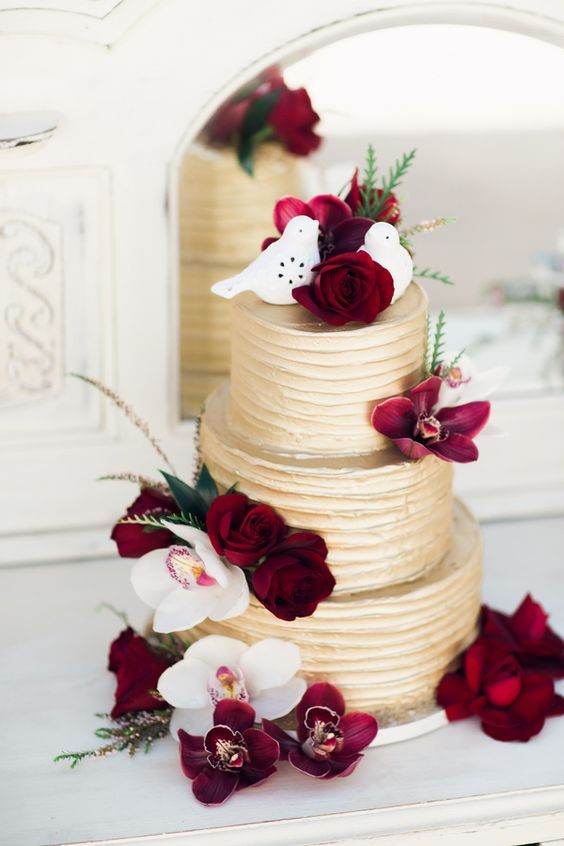 awesome burgundy and gold wedding cake