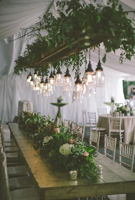 backyard tent wedding with simple greenery chandelier