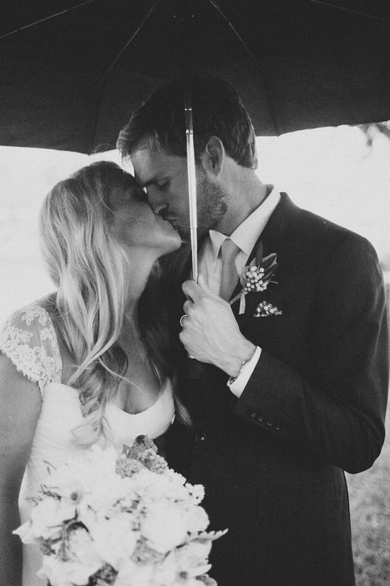 best rainy day wedding photo ever
