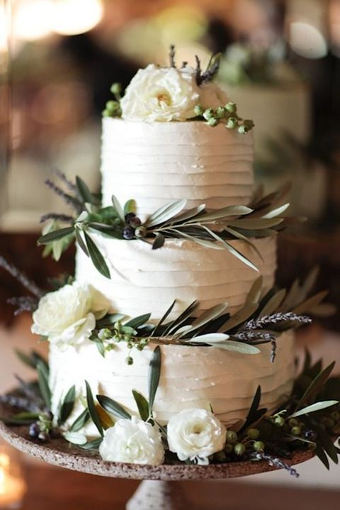 classic white wedding cake with greenery decoration
