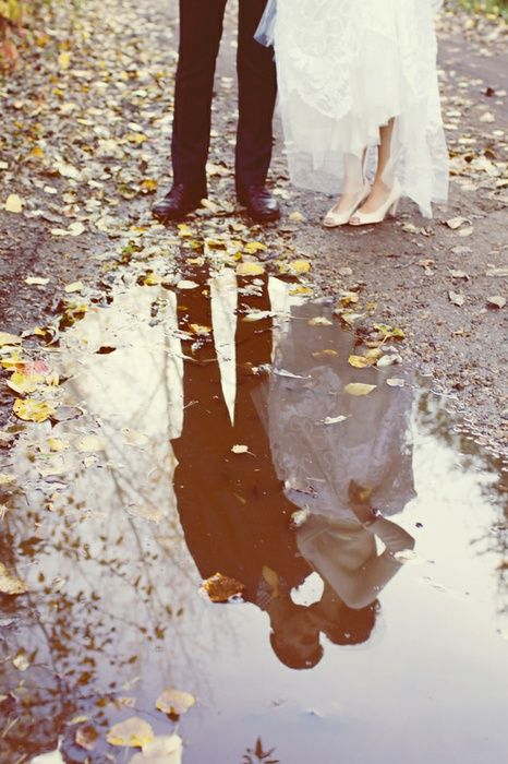 creative fall wedding photo in a rain