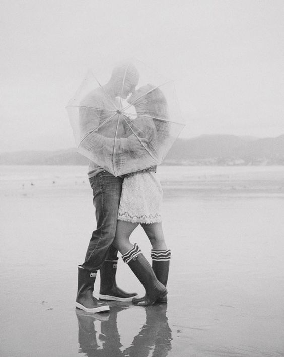 hopelessly romantic rainy wedding photo