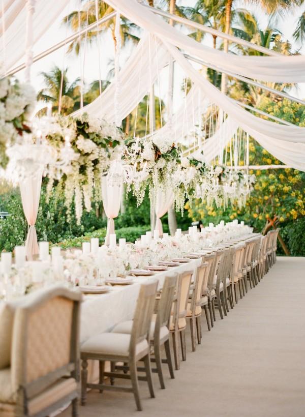 luxury wedding chandelier with fresh flowers and greenery